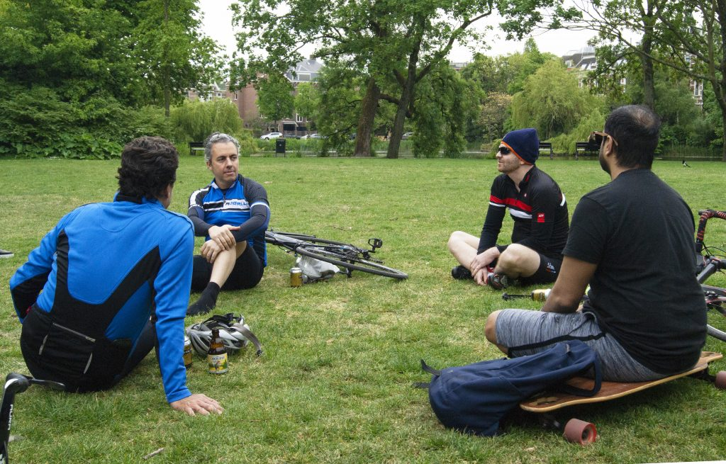 Four men having a beer in Vondelpark